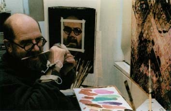 In the middle of his career, artist Chuck Close became partially paralyzed due to a blood clot in his spinal column. To continue painting, he developed a technique that allowed him to work with his weakened hands from his wheelchair. He is still able to create the large, multicolored portraits for which he is known. A/P Associated Press